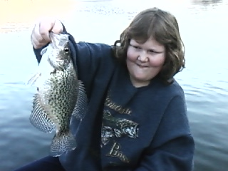 her first crappie of 09