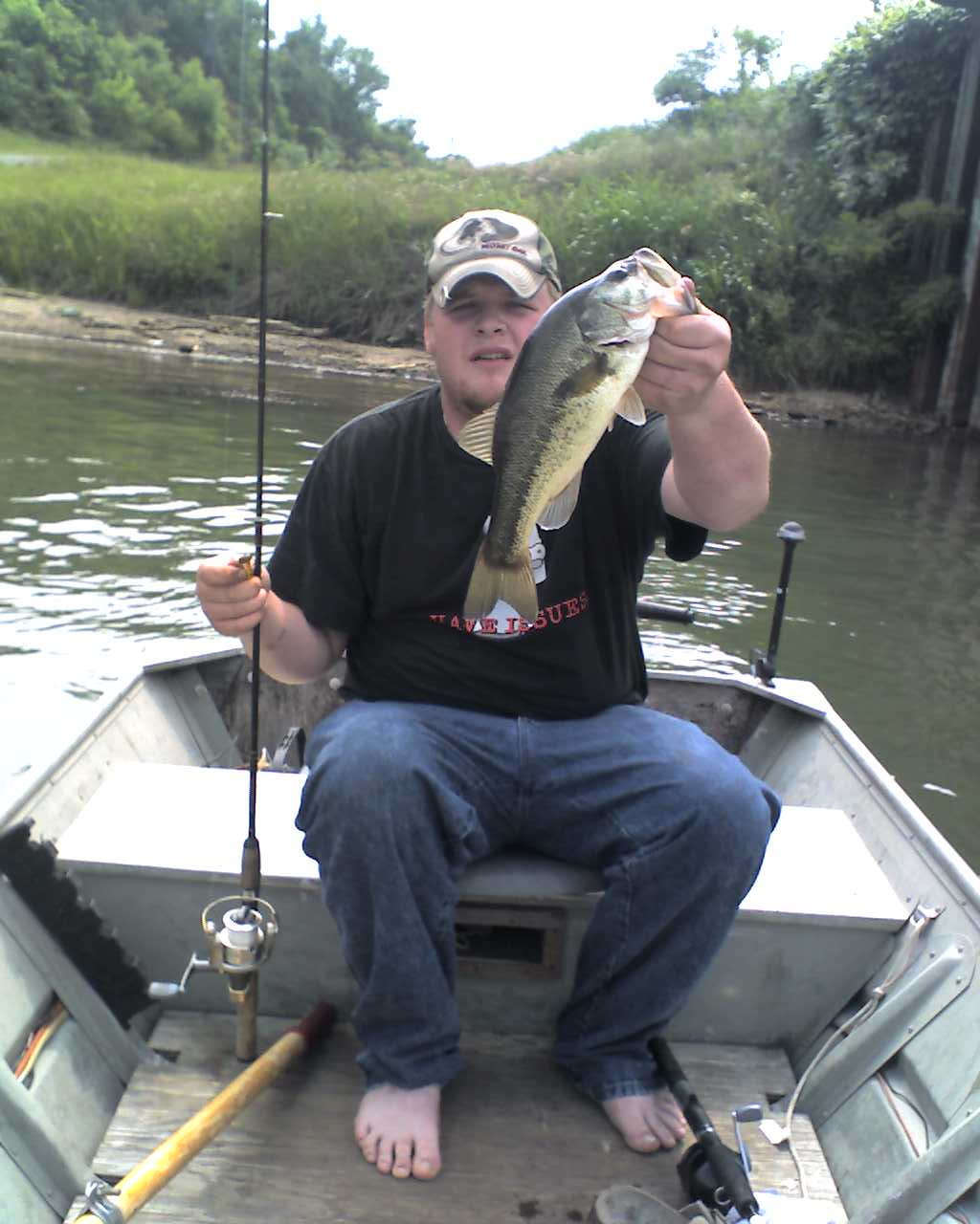 catching bass bare footed in a flatbottom. dont get much better than that.