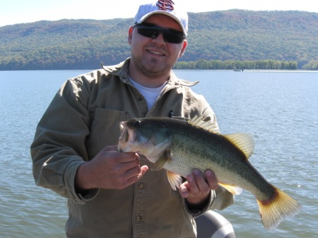 SonInLaw Drew with a nice bass caught at Barrett Lake using a Zara Pup. (10.17.10)