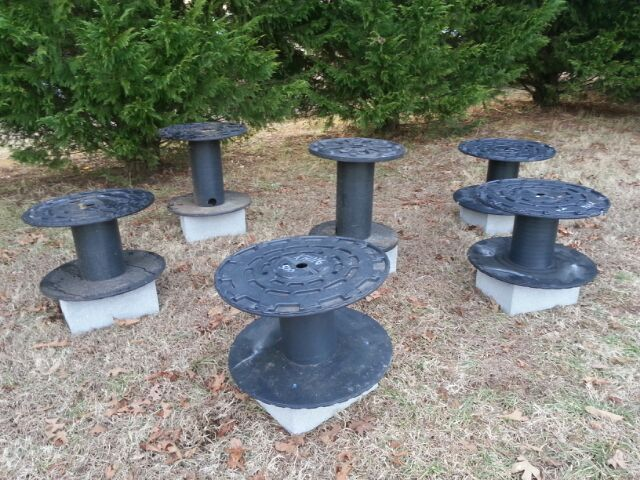Fish attractor stumps made of old plastic spools and large concrete blocks.